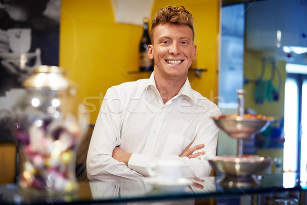 Stock photo: happy man working as barman smiling in bar