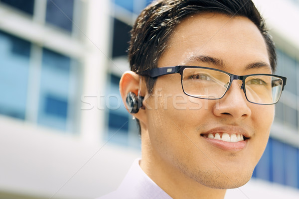 Headshot Business Man With Bluetooth Handsfree Device Stock photo © diego_cervo