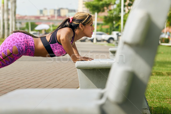 Woman Training Pectorals Doing Pushups On Street Bench Stock photo © diego_cervo