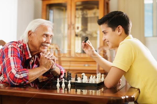 Dede oynama satranç tahtası oyun torun ev Stok fotoğraf © diego_cervo