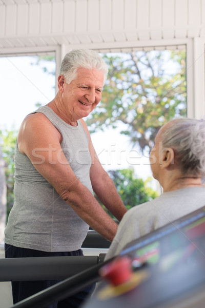 Active senior friends talking and working out in fitness club Stock photo © diego_cervo
