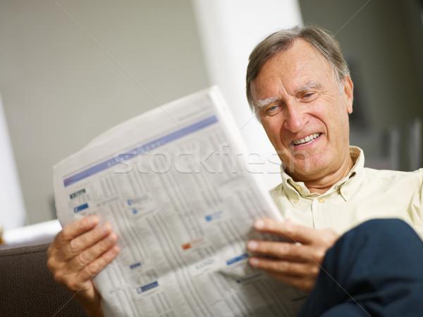 Senior man reading stock listings  Stock photo © diego_cervo