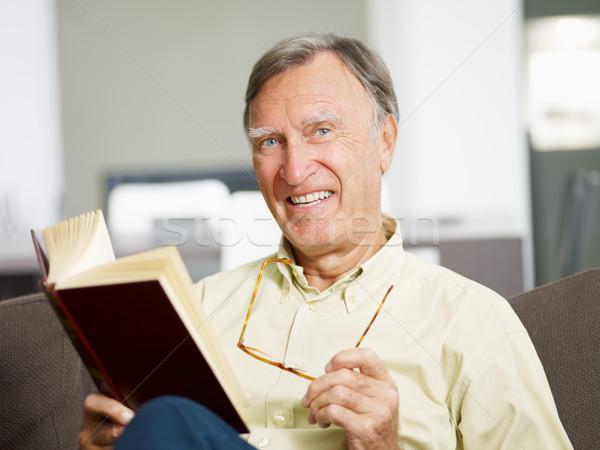 Kıdemli adam okuma kitap ev bakıyor Stok fotoğraf © diego_cervo