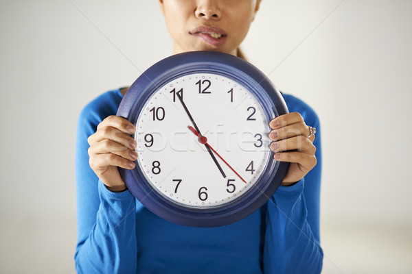 asian girl holding big blue clock with stress Stock photo © diego_cervo