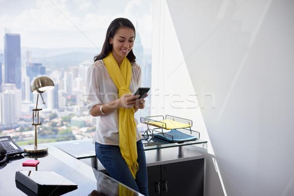 Business woman sms telefonu biuro młodych Zdjęcia stock © diego_cervo