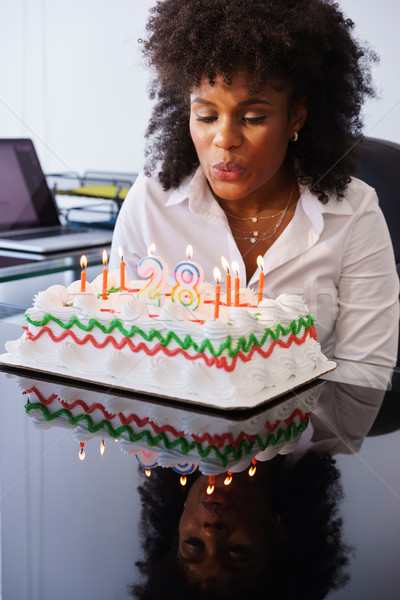 Business Woman Celebrating Birthday Party In Office Blowing Cand Stock photo © diego_cervo