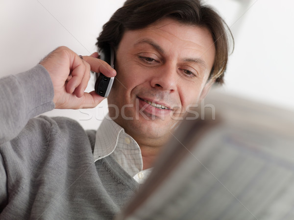 adult man reading stock exchange listings at home Stock photo © diego_cervo