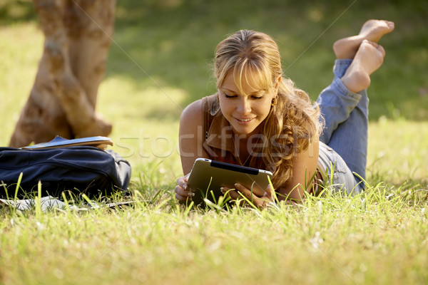 Woman with books and ipad studying for college test Stock photo © diego_cervo