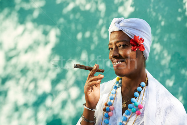 Portrait of cuban black woman smoking cigar Stock photo © diego_cervo