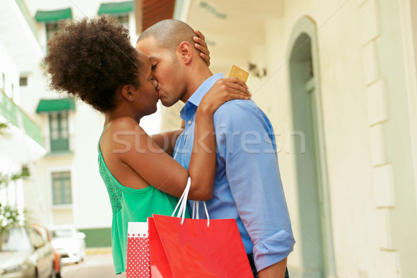 African American Couple Shopping With Credit Card Kissing Stock photo © diego_cervo