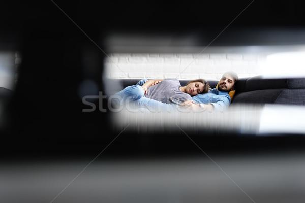 Fiatal pér alszik kanapé néz tv fiatal Stock fotó © diego_cervo