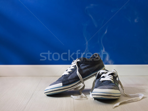 stinking worn-out shoes left on wooden floor  Stock photo © diego_cervo