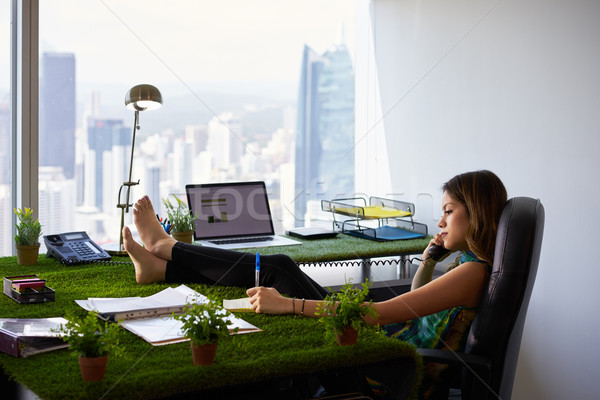 Environmentalist Woman Writes Note Barefeet On Office Desk Stock photo © diego_cervo