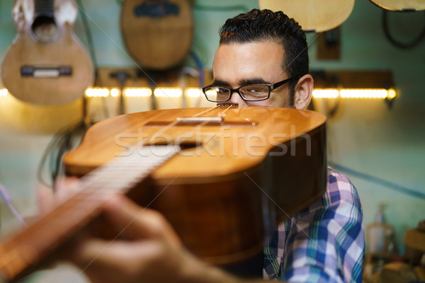 Lute Maker Checking Bridge And Arm Of Classic Guitar Stock photo © diego_cervo