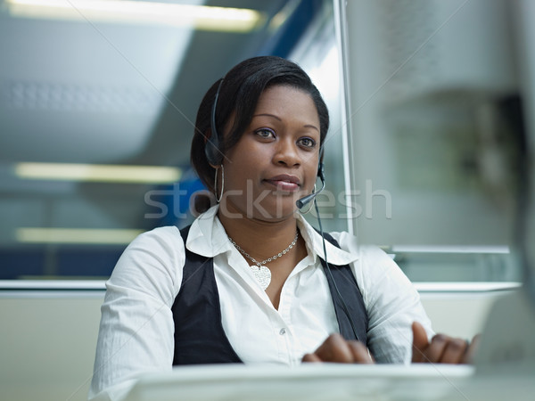 Stock photo: adult woman working in call center