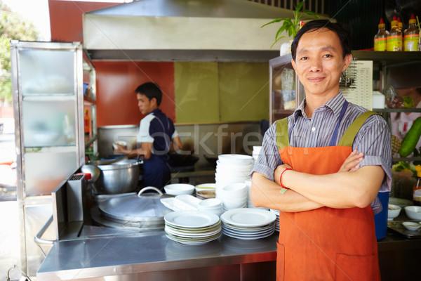 Man werken kok asian restaurant keuken Stockfoto © diego_cervo