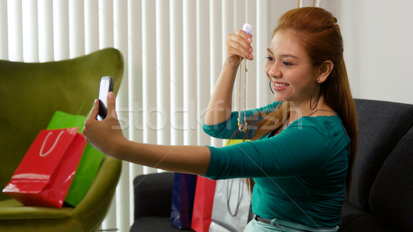 Latina Girl With Shopping Bags Taking Selfie With Phone Stock photo © diego_cervo