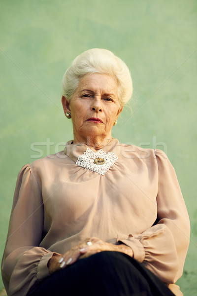 Portrait of serious old caucasian woman looking at camera Stock photo © diego_cervo