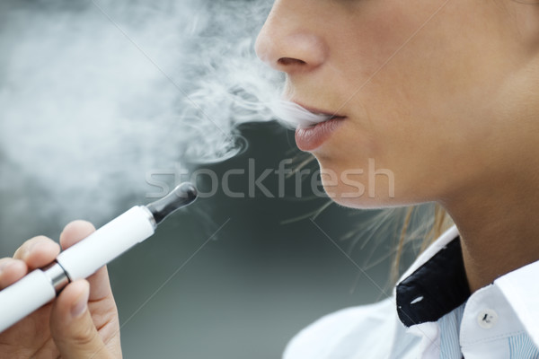 closeup of woman smoking electronic cigarette outdoor Stock photo © diego_cervo