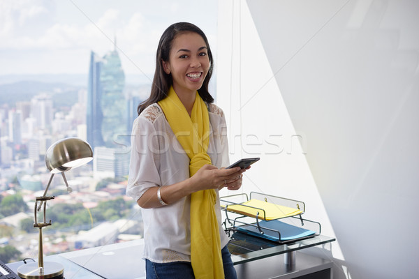 Young Latina Business Woman With Phone In Office 2 Stock photo © diego_cervo