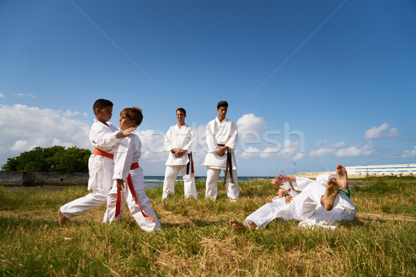 School Teachers And Children At Karate Lesson Near The Sea Stock photo © diego_cervo
