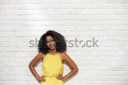 Fiatal afroamerikai nő téglafal elvesz vitamin tabletták Stock fotó © diego_cervo