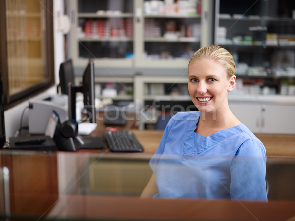 Woman working as nurse at reception desk in clinic Stock photo © diego_cervo