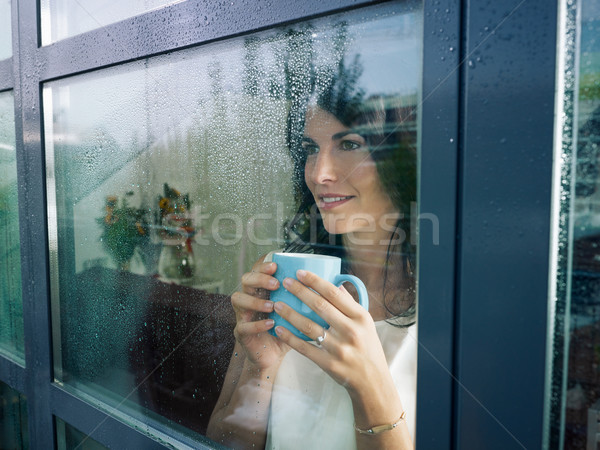 woman staring at the window Stock photo © diego_cervo