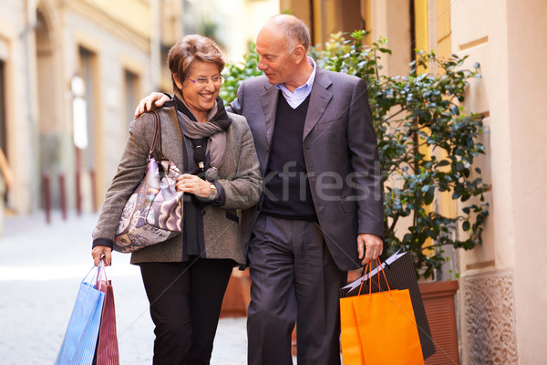 Stock photo: senior old man and woman shopping in Italy
