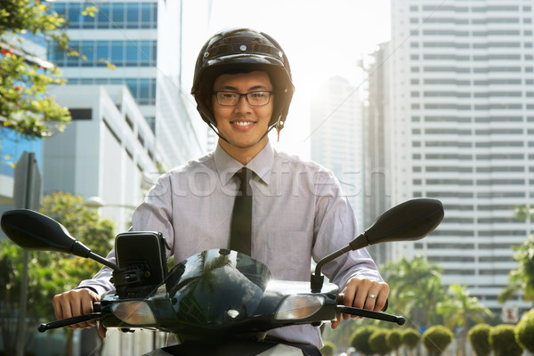 Chinese Businessman Commuter Using Scooter Motorcycle In City Stock photo © diego_cervo