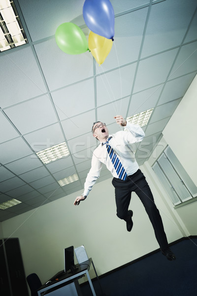 businessman flying in office with balloons Stock photo © diego_cervo
