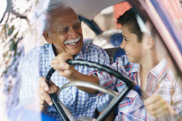 Old Man Grandpa Gives Driving Class To Grandson Stock photo © diego_cervo