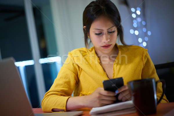 College Student Studying At Night Types Message On Phone Stock photo © diego_cervo