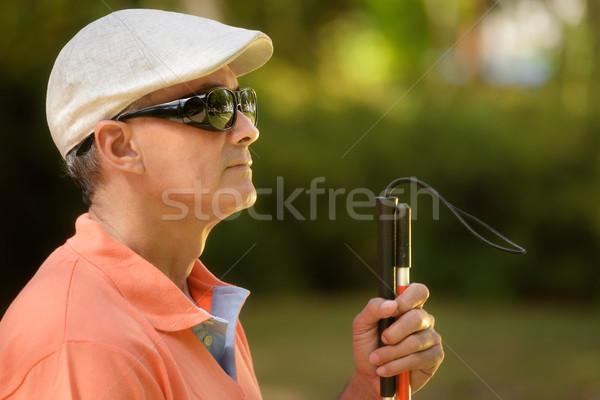 Portret niewidomych człowiek posiedzenia miasta parku Zdjęcia stock © diego_cervo