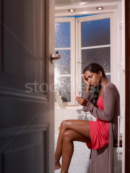 üzücü kadın gebelik testi siyah kadın banyo Stok fotoğraf © diego_cervo