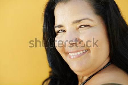 Maturo ispanico donna sorridente fotocamera ritratto americano Foto d'archivio © diego_cervo