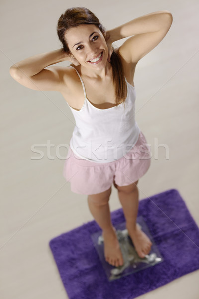 happy woman on scales satisfied for weight loss Stock photo © diego_cervo