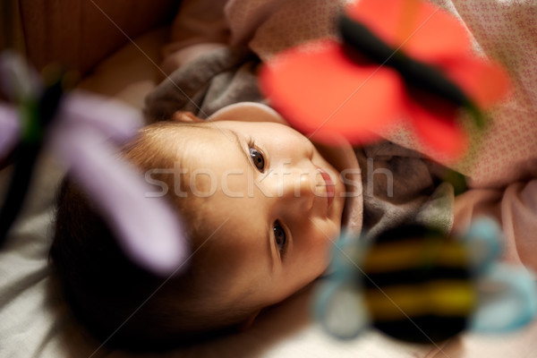 Beautiful little female baby smiling and playing with animal toy Stock photo © diego_cervo