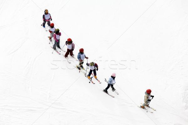 Téli tájkép gyerekek tanul sí oktató hó Stock fotó © diego_cervo