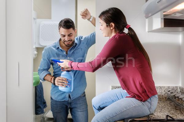 Homme femme lavage vêtements Photo stock © diego_cervo