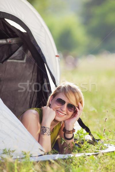 Kadın çadır genç sarışın kadın bakıyor kamera Stok fotoğraf © diego_cervo