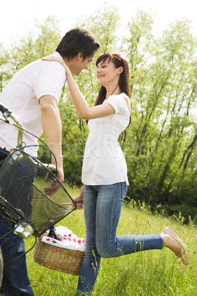 луговой пару парка целоваться Сток-фото © diego_cervo