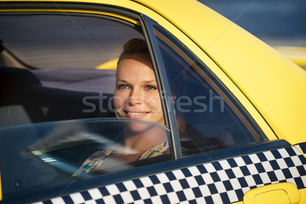 people travelling-business woman in yellow taxi Stock photo © diego_cervo