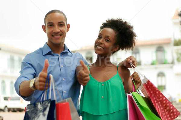 Portrait African American Couple Shopping Smiling With Thumb up Stock photo © diego_cervo