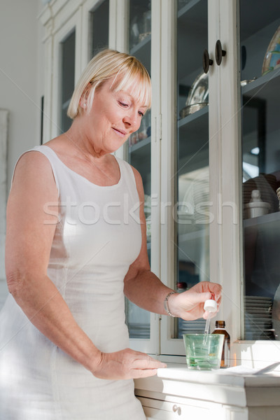 Health issues, old woman taking prescription drugs Stock photo © diego_cervo