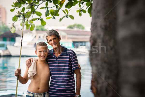 Happy family portrait of boy and grandpa hugging Stock photo © diego_cervo