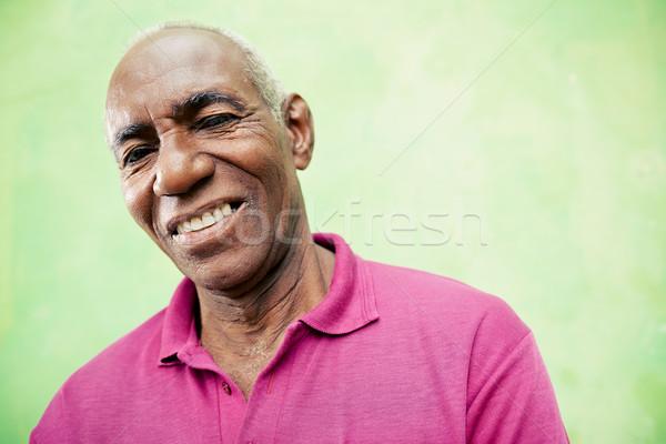 Retrato idoso homem negro olhando sorridente câmera Foto stock © diego_cervo