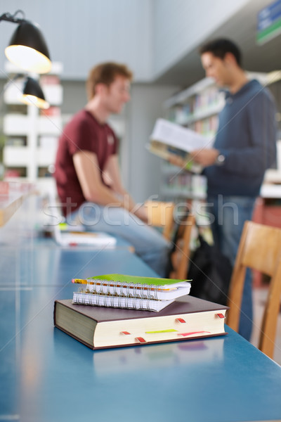 book and notepads on desk in library Stock photo © diego_cervo