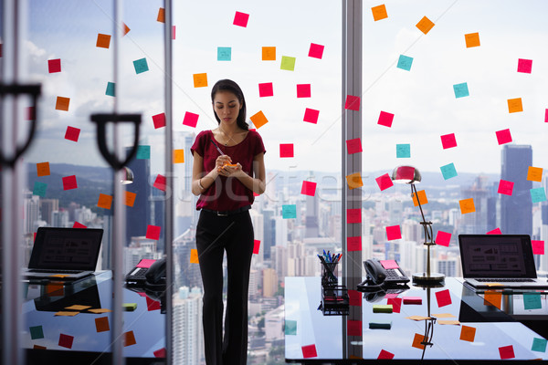 Busy Person Writing Many Sticky Notes On Large Window Stock photo © diego_cervo