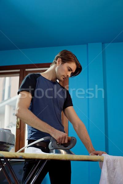 man with iron doing chores Stock photo © diego_cervo